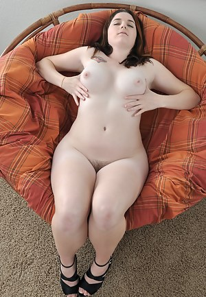 Cerah lifts her long legs and shows off her puffy hairy snatch before busting out her pale perky tits and curvy natural body.