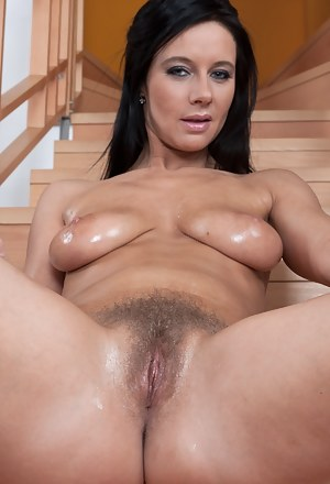 After a hard day at the office, hairy girl Enza just wants to change into something comfortable. On her way up she decides to strip down, rubbing her hairy pussy right there on the stairs!