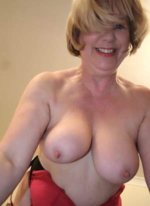 Lovely mature slut playing with her pussy